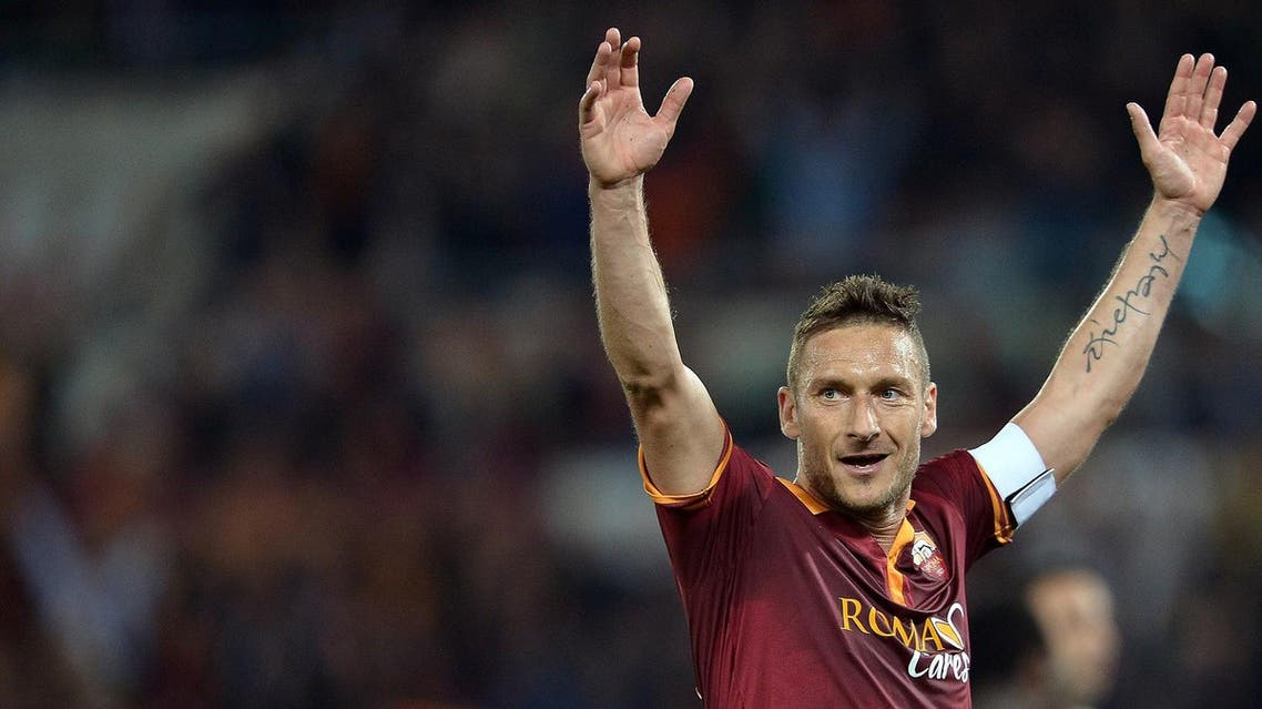 (FILES) This file photo taken on April 25, 2014 shows AS Roma's forward Francesco Totti celebrate after Roma scored during the Italian Serie A football match between AS Roma and AC Milan at the Olympic stadium in Rome. Roma legend Francesco Totti confirmed his retirement on July 17, 2017 and will take a directorship role at the Serie A club. (AFP)