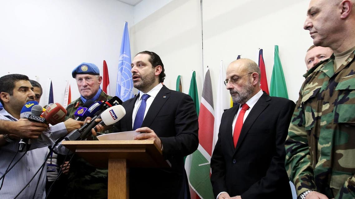 Lebanese Prime Minister Saad Hariri (C) talks to the press next to the Head of Mission and Force Commander of the United Nations Interim Force in Lebanon (UNIFIL), Major General Michael Beary (L) of Ireland and Lebanon's Defence Minister Yaacub Sarraf (2-R) during a visit to the UNIFIL headquarters in the southern Lebanese village of Naqura on April 21, 2017. (AFP)