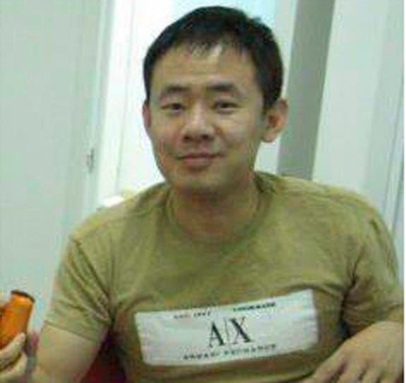 This 2009 handout photo released by a friend of Xiyue Wang shows Xiyue Wang at his apartment in Hong Kong, (AP)