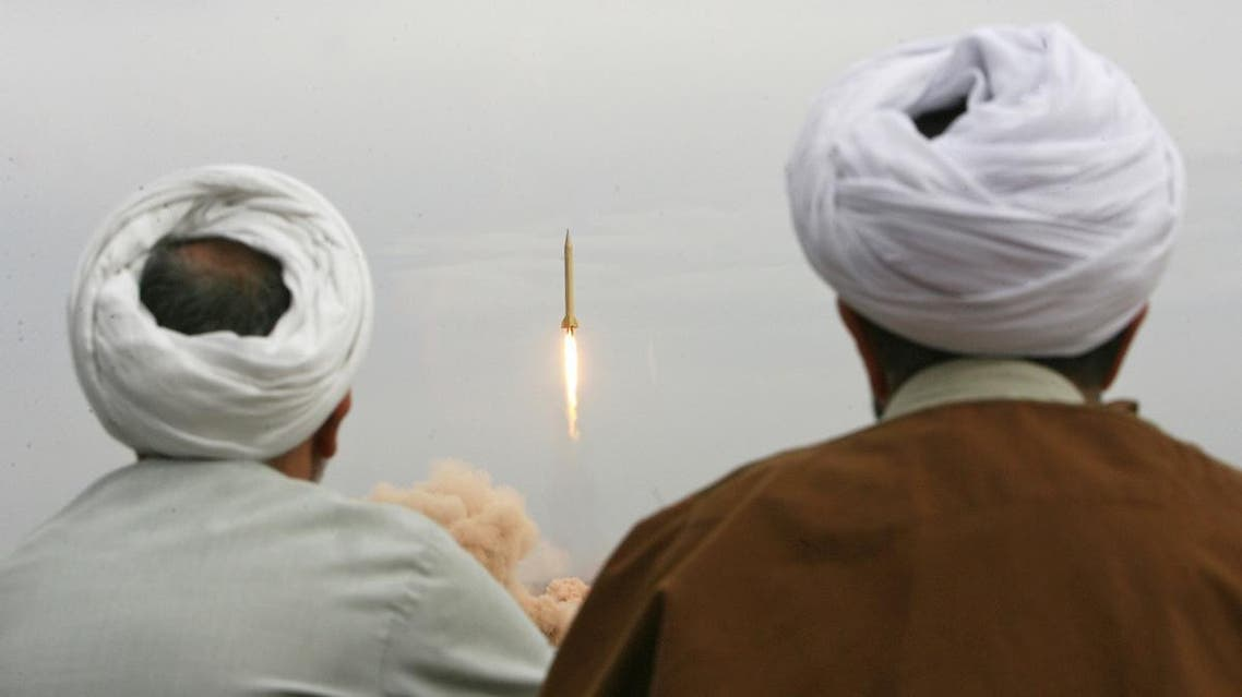 Iranian clergymen watch a Shahab-3 long-range ballistic missile fird by Iran's Revolutionary Guards in the desert outside the holy city of Qom. (File photo: AFP)