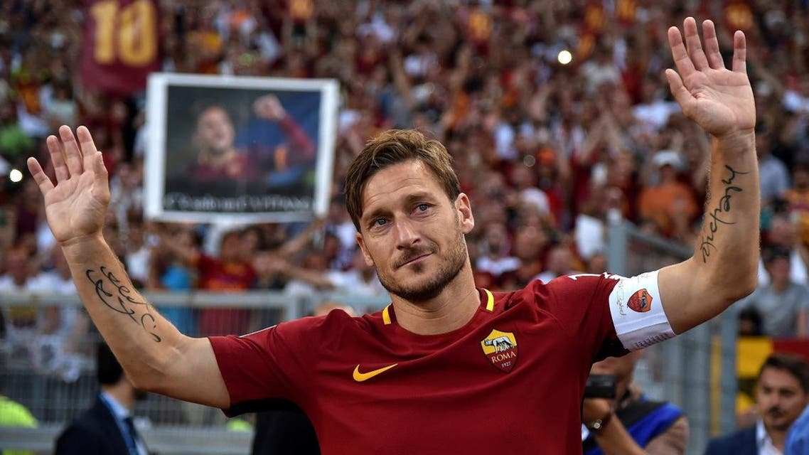 AS Roma's Francesco Totti waves to supporters after his final game. (Reuters)