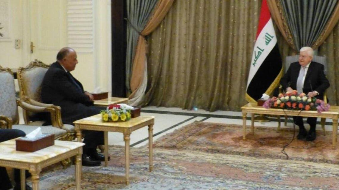 الرئيس العراقي فؤاد معصوم ووزير الخارجية المصري سامح شكري