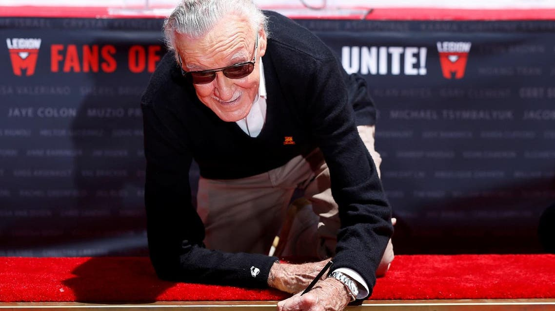 Stan Lee places his signature in cement during a ceremony in the forecourt of the TCL Chinese theatre in Los Angeles, California on July 18, 2017. (Reuters)