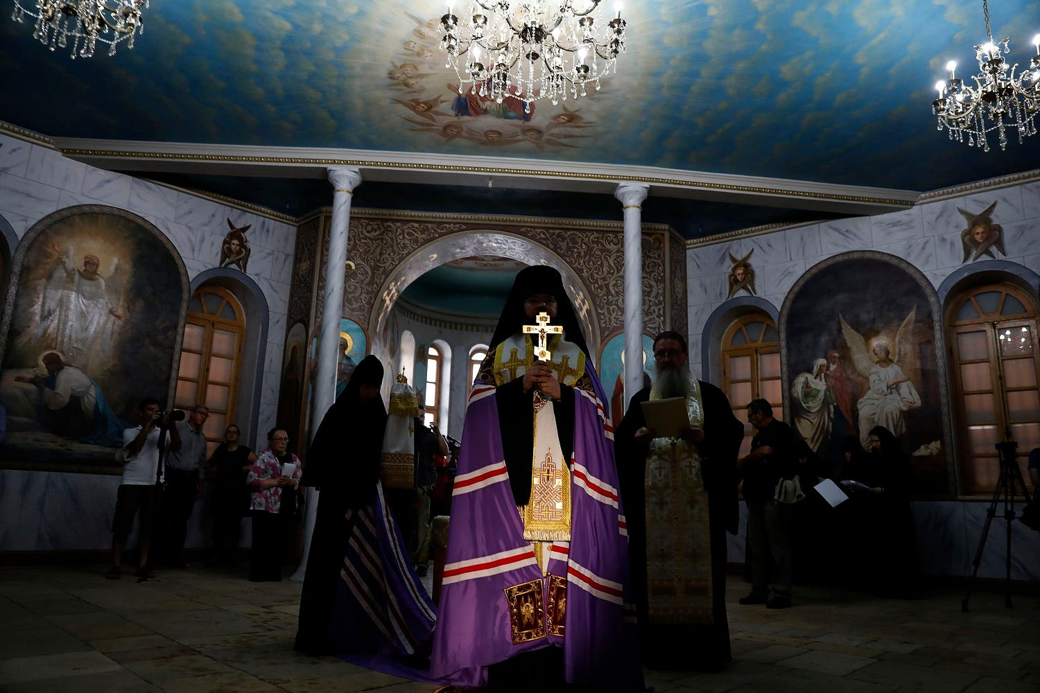 Russian-Orthodox religious figures attend the re-opening of the Sergei Compound in Jerusalem, on July 18, 2017, after six years of renovation work. (AF)