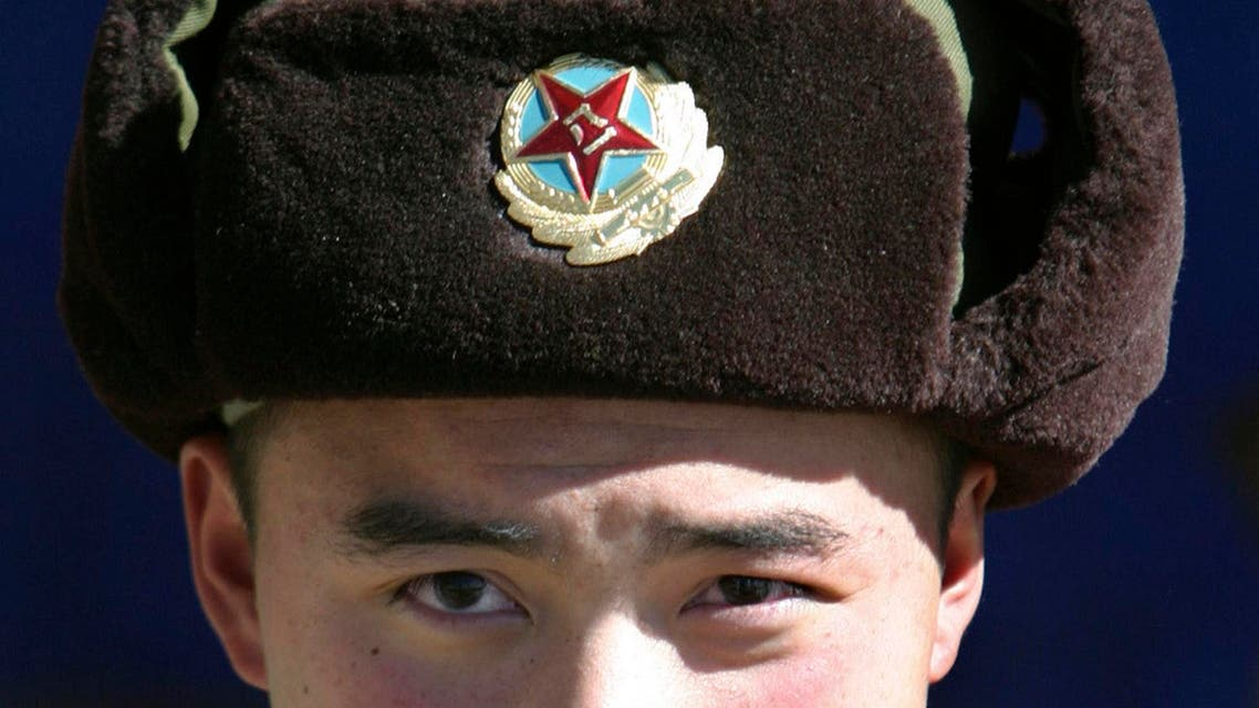 A Chinese soldier looks into the camera at the India-China trade route at Nathu-La, 55 km north of Gangtok, capital of India's state of Sikkim, January 17, 2009. (Reuters)