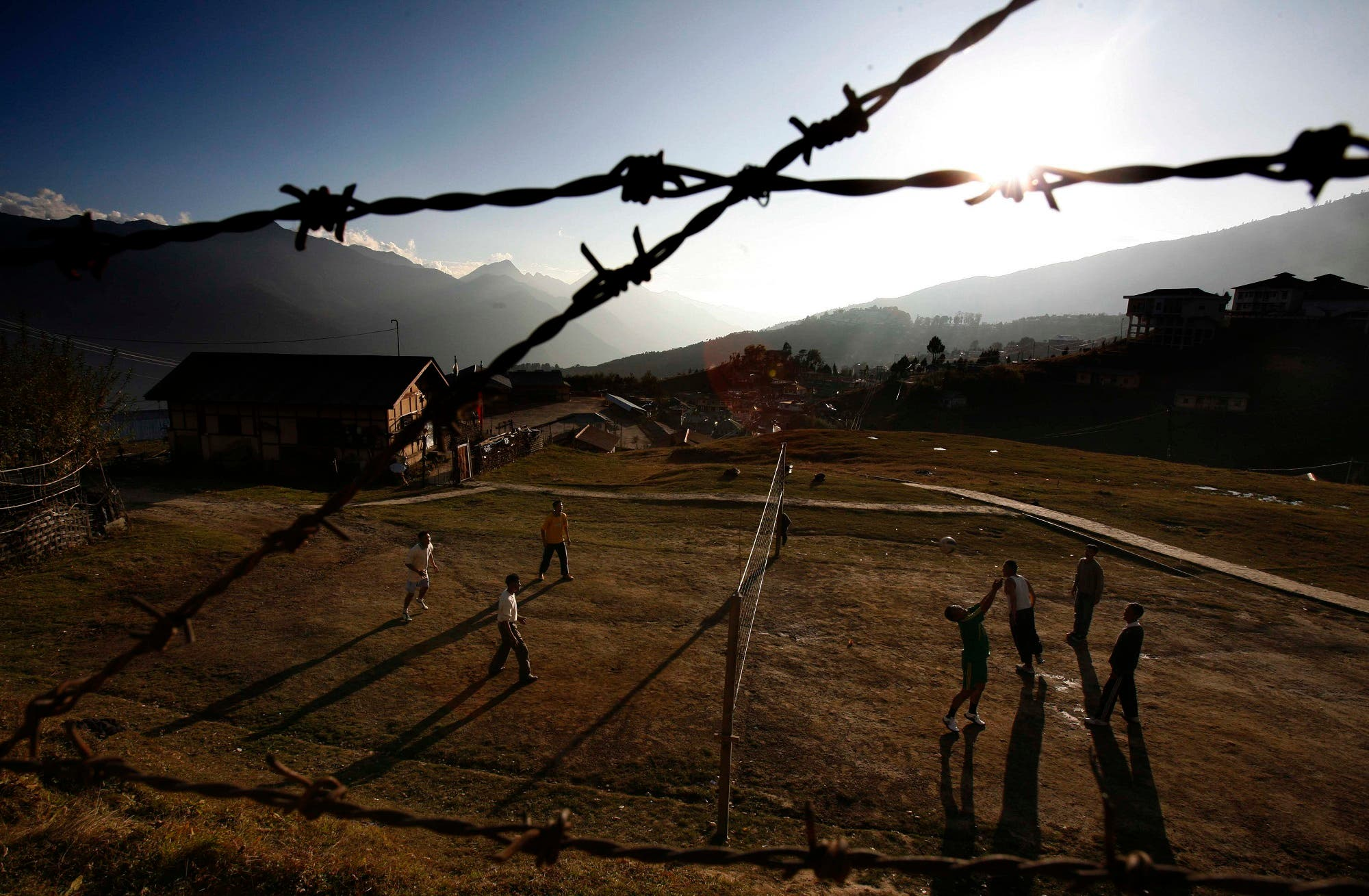 Policemen play volleyball in Tawang, in the northeastern Indian state of Arunachal Pradesh, Nov. 5, 2009. The Indian government refused Thursday to allow foreign journalists to cover the visit of the Tibetan spiritual leader Dalai Lama to the northeastern state at the heart of a long-running border dispute with China. (AP)