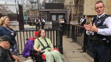 """لأول مرة في بريطانيا: ذوو الاحتياجات الخاصة """"يحتجون"""""""