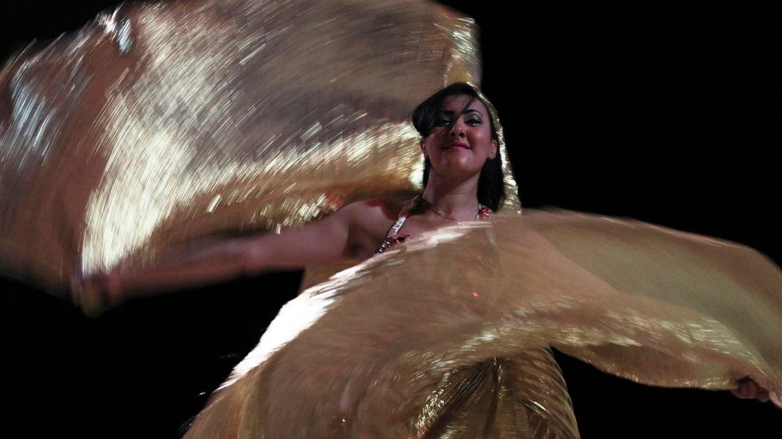 An Egyptian belly dancer performs at the Badium Sinai Arabic concert in the Red Sea resort of Sharm el-Sheikh, south of Cairo July 12, 2012. (Reuters)