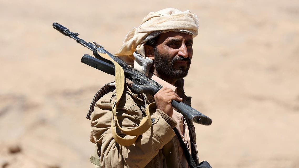 A pro-government government tribal fighter carries his weapon as he walks in Fardhat Nahm area, which has recently been taken by the army from Houthi rebels around 60km (40 miles) from Yemen's capital Sanaa, February 20, 2016. REUTERS/Ali Owidha
