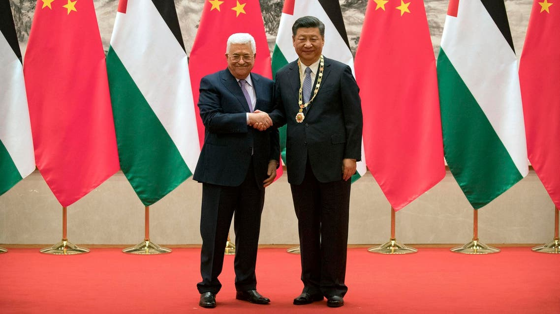 Mahmoud Abbas and Xi Jinping during a signing ceremony at the Great Hall of the People in Beijing on July 18, 2017. (AFP)