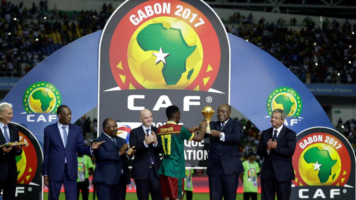Issa Hayatou, President of the Confederation of African Football, hands the winner's trophy to Cameroon's Arnaud Djoum at the end of the African Cup of Nations final soccer match between Egypt and Cameroon at the Stade de l'Amitie, in Libreville, Gabon, Sunday, Feb. 5, 2017. (AP)
