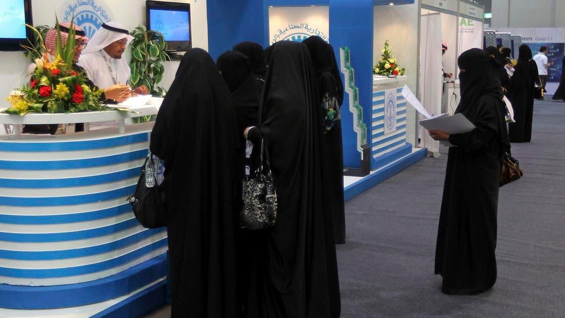 Saudi Arabian women, seeking a job, talk with recruiters during a job fair in Riyadh January 25, 2012. (Reuters)