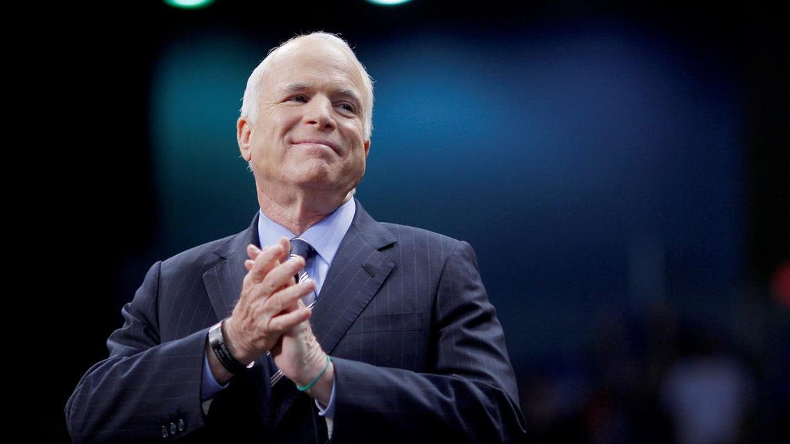 Senator John McCain listens as he is introduced at a campaign rally in Fayetteville, North Carolina, on October 28, 2008. (Reuters)