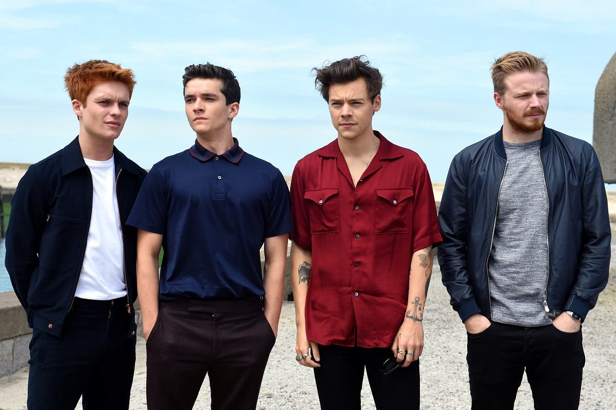 (From L) British actor Tom Glynn-Carney, British actor Fionn Whitehead, British singer, songwriter and actor Harry Styles and British actor Jack Lowden pose during a photo-call before Dunkirk's release. (AFP)