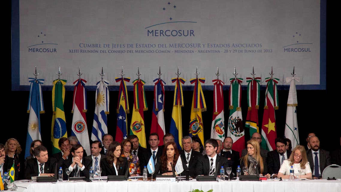 Argentina's President Cristina Fernandez, center, delivers a speech at the Mercosur summit in Mendoza, Argentina, Friday, June 29, 2012.ap