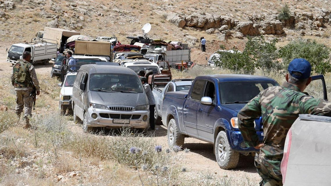 Hezbollah members escort a convoy of Syrian refugees at the border town of Arsal, Lebanon July 12, 2017. (Reuters)