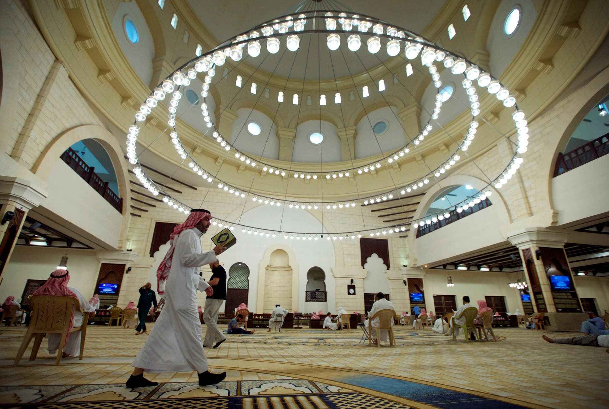 A man walks as he reads the Koran in a mosque during the fasting month of Ramadan, in Riyadh on May 29, 2017. (Reuters)