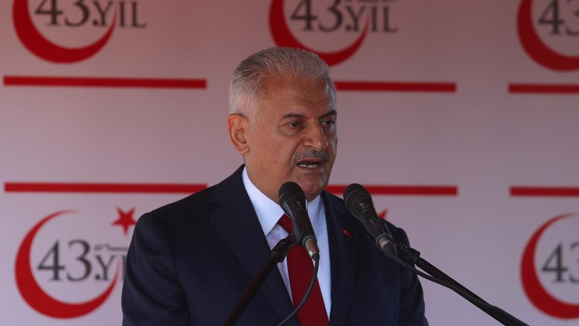 Turkish Prime Minister Binali Yildirim delivers a speech before a parade to mark the 1974 Turkish invasion of Cyprus in response to a briefly lived Greek-inspired coup, in the Turkish-administered northern part of Nicosia, Cyprus July 20, 2017. (Reuters)