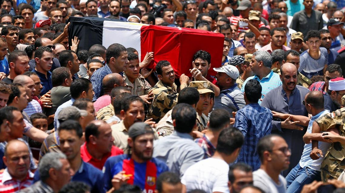 Relatives and friends carry the coffin of the officer Khaled al-Maghrabi, who was killed during a suicide bomb attack on an army checkpoint in Sinai, during his funeral in his hometown Toukh, Al Qalyubia Governorate, north of Cairo, on July 8, 2017. (Reuters)