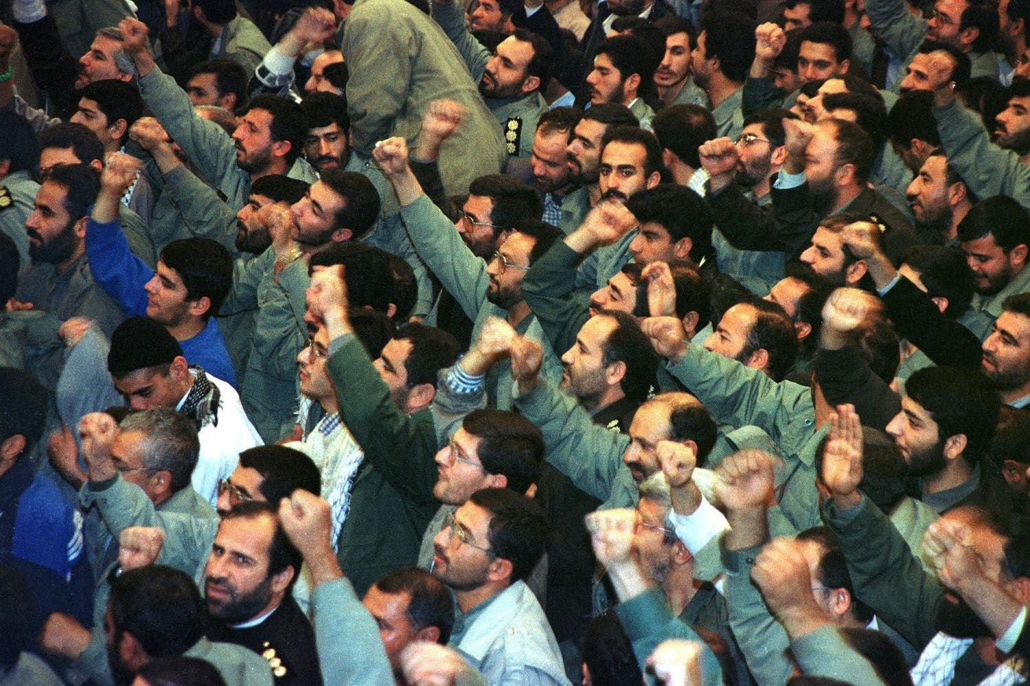Members of the IRGC cheer during the speech of Iran's Supreme Leader Ayatollah Ali Khamenei on the occasion of IRGC Week in Tehran 13 November 1999. (AFP)