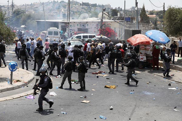 Palestinians clash with Israeli forces after Friday prayer on a street outside Jerusalem's Old city July 21, 2017. Reuters
