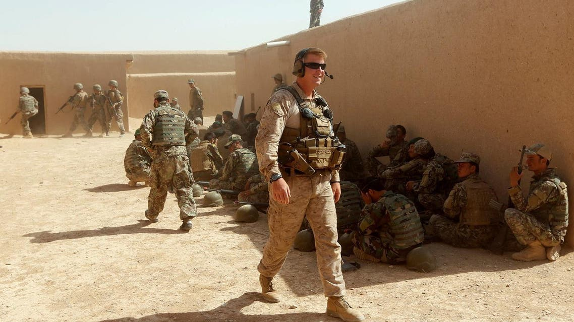 A US Marine (C) walks as Afghan National Army (ANA) soldiers attend a training exercise in Helmand province, Afghanistan July 5, 2017. (Reuters)