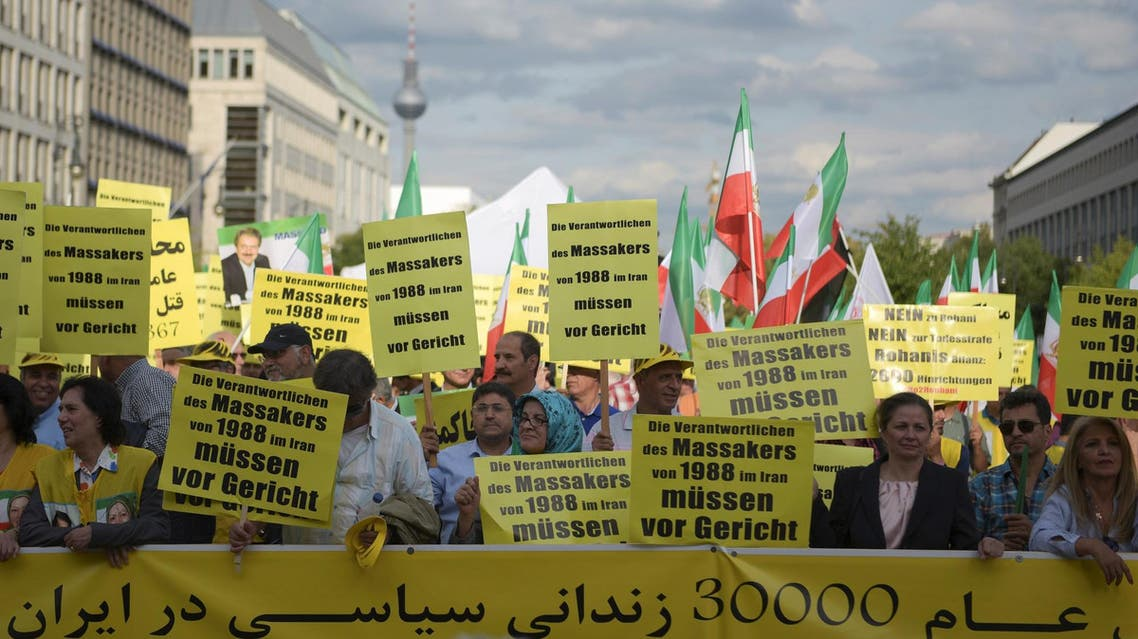 Activists hold banners during a demonstration against executions in Iran, in Berlin, Germany September 3, 2016. Banners in German read 'The people who are responsible for the 1988 massacres in Iran need to be brought to court.' (Reuters)