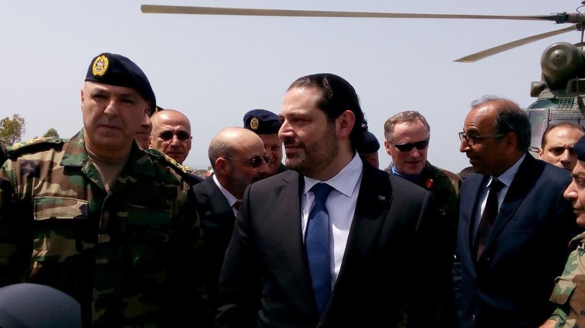Saad al-Hariri arrives with Army Commander General Joseph Aoun (L) at the United Nations Interim Force in Lebanon (UNIFIL) headquarters in Naqoura, southern Lebanon April 21, 2017. (Reuters)