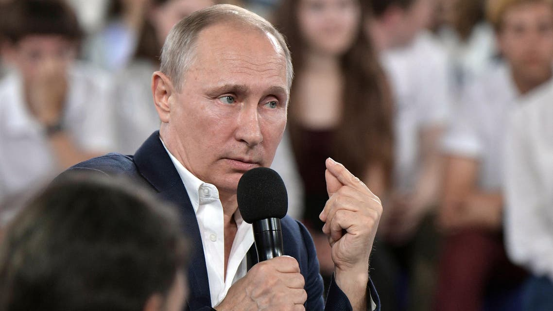 """Russian President Vladimir Putin (R) speaks as he arrives during the """"A Grown-up Conversation with Vladimir Putin"""" TV show held at the Sirius educational center for gifted children in Sochi on July 21, 2017."""