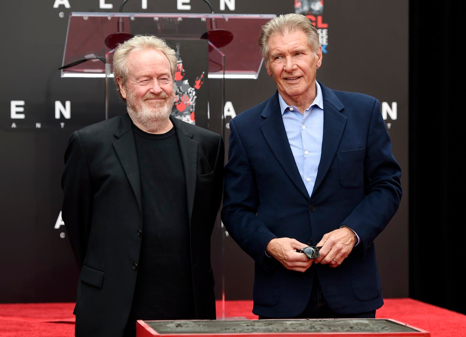 Director Sir Ridley Scott (left) and actor Harrison Ford pose together at the TCL Chinese Theatre on May 17, 2017 in Los Angeles. Scott directed Ford in the classic 1982 science fiction film 'Blade Runner.'(AP)