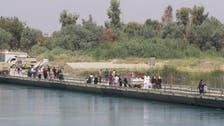 جسر عائم.. همزة الوصل الوحيدة أمام سكان الموصل