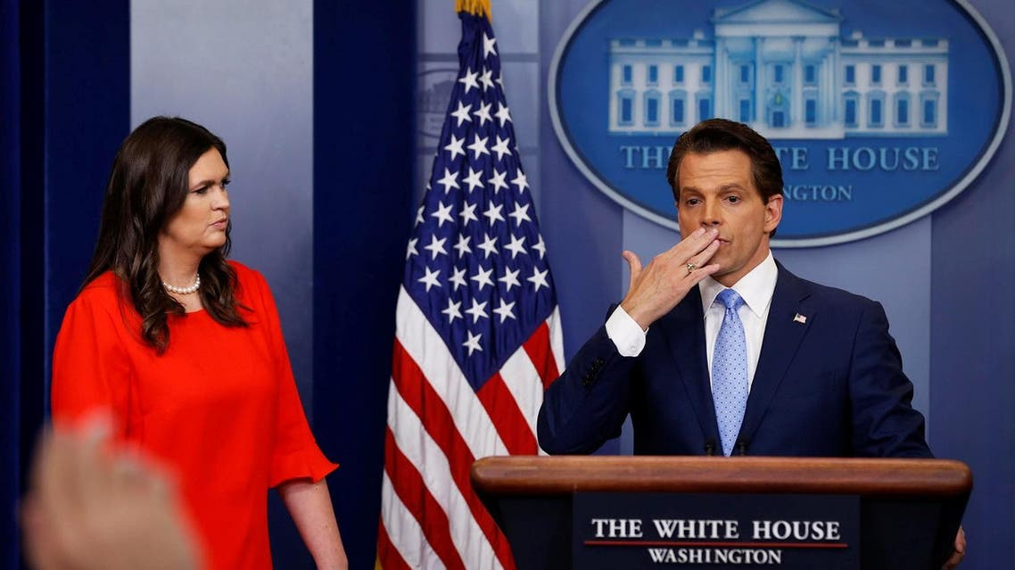 New White house Communications Director Anthony Scaramucci (right), flanked by White House Press Secretary Sarah Sanders, blows a kiss to reporters after addressing the daily briefing on July 21, 2017. (Reuters)