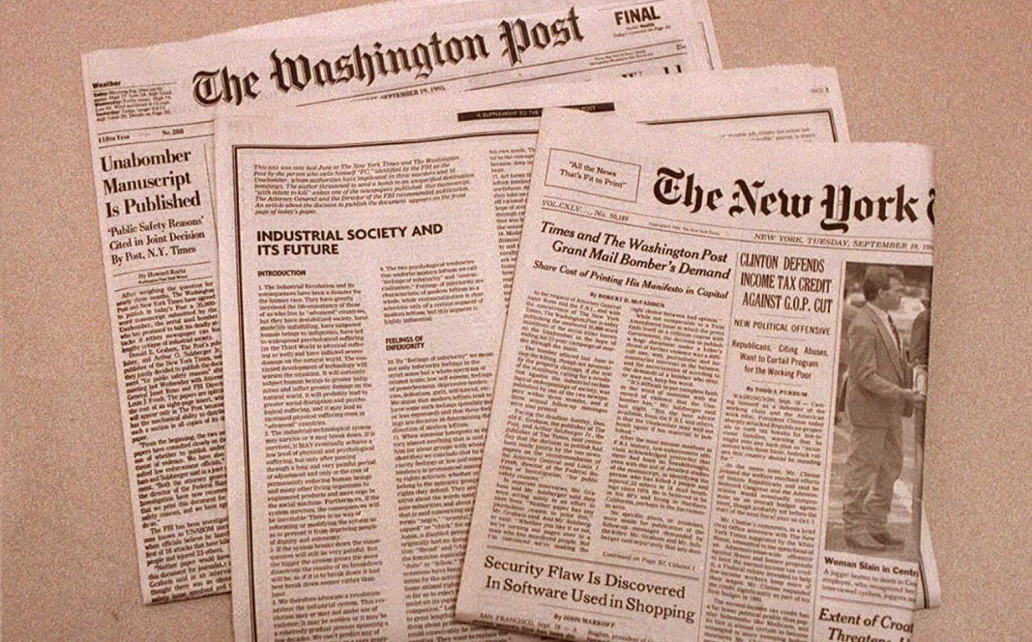 This 19 September photo shows the front pages of the New York Times and the Washington Post. (AFP)