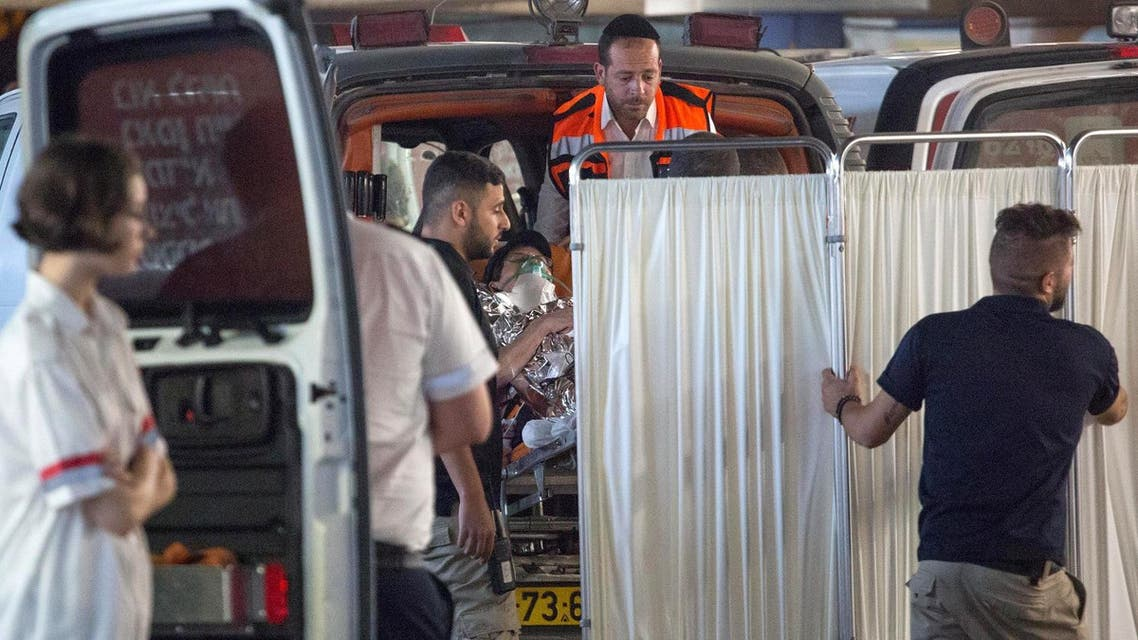 Medics evacuate an Israeli woman who was injured during a knife attack in the Jewish settlement of Neve Tsuf at the West Bank, at a hospital in Jerusalem July 21, 2017. (Reuters)