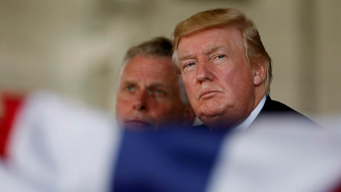 U.S. President Donald Trump, flanked by Virginia Governor Terry McAuliffe, participates in the commissioning ceremony of the aircraft carrier USS Gerald R. Ford at Naval Station Norfolk in Norfolk, Virginia, U.S. July 22, 2017.