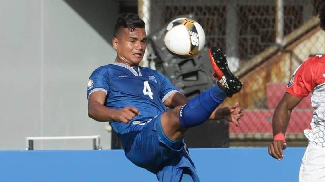 El Salvador's Henry Romero, left, controls the ball as Belize's Michael Salazar looks on during a Central America Cup soccer match in Panama City, Tuesday, Jan. 17, 2017. (AP)