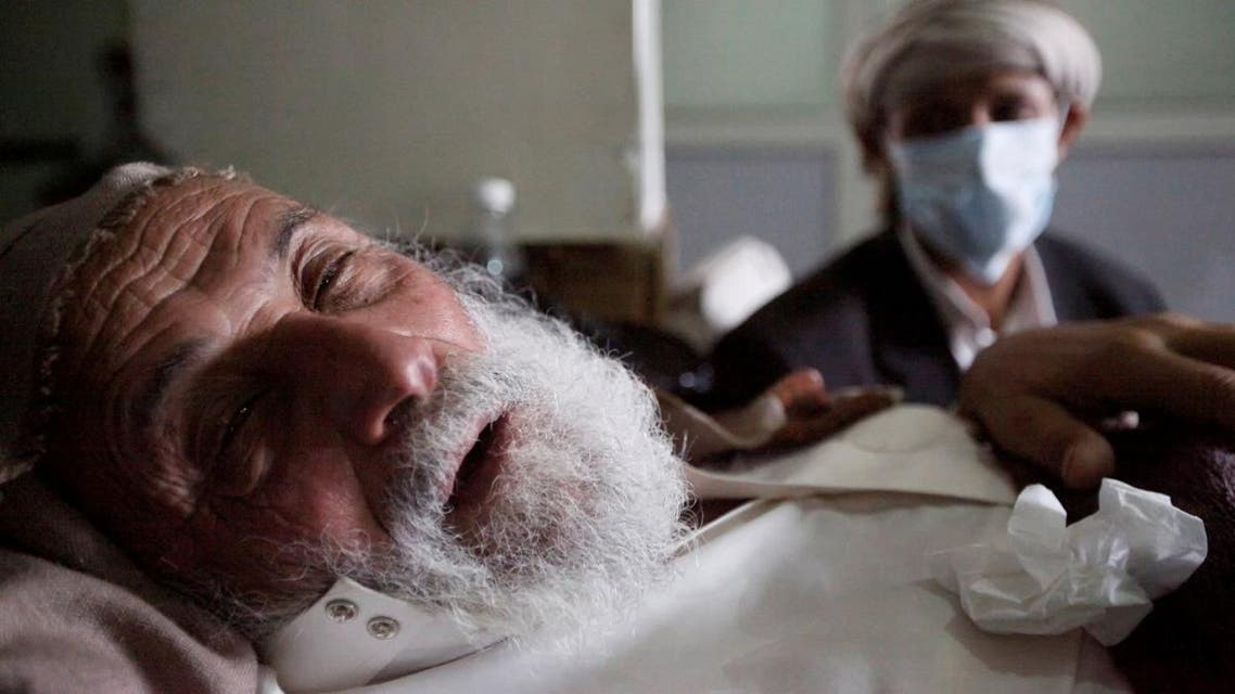 An old man infected with cholera lies on the bed at a hospital in Sanaa. (File photo: Reuters)