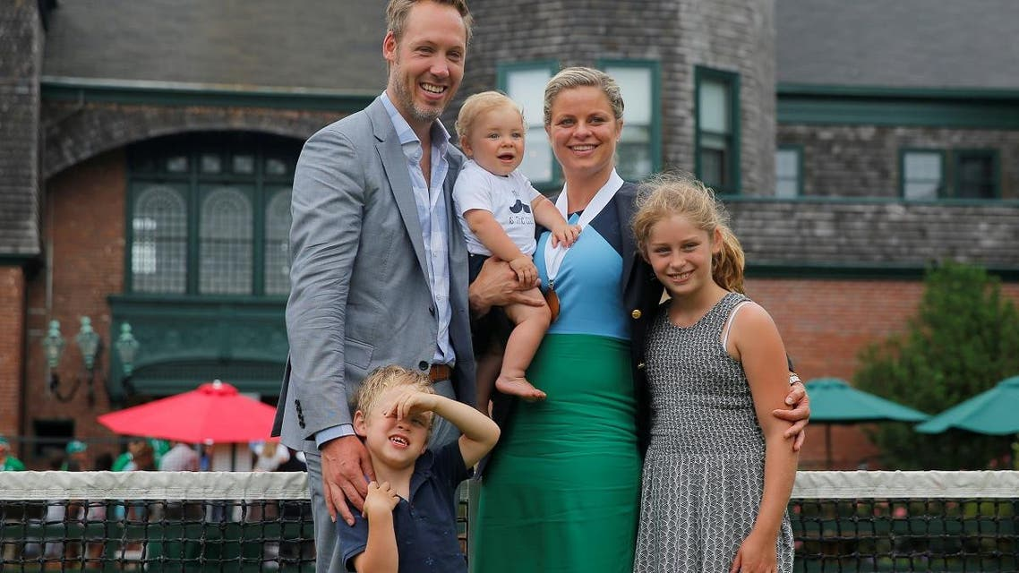 Kim Clijsters of Belgium and her family pose for a photograph after she was inducted into the International Tennis Hall of Fame in Newport. (Reuters)