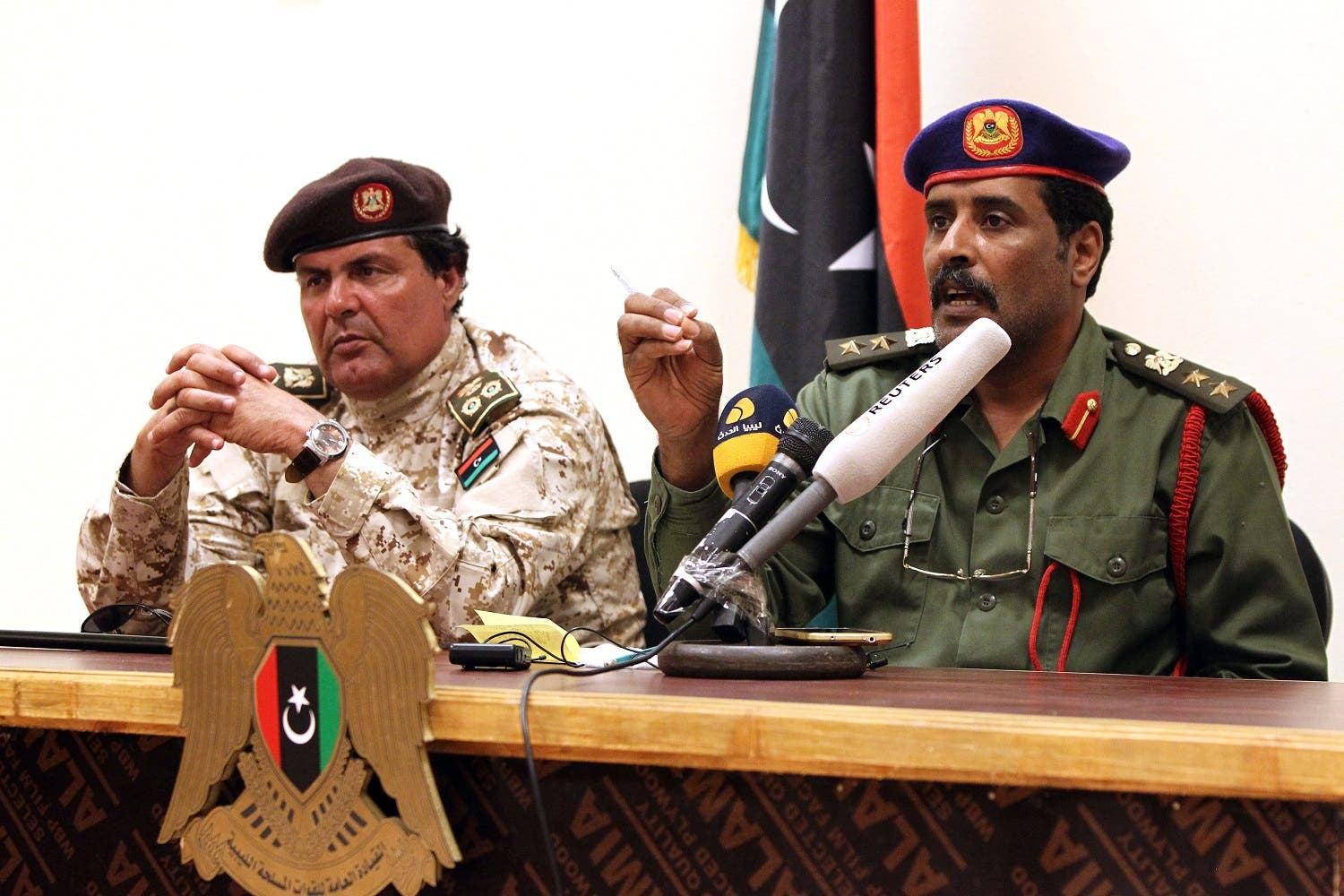 Colonel Muftah al-Muqarief (L), who heads oil guards loyal to Libyan military strongman General Khalifa Haftar Haftar, and Colonel Ahmad Mesmari, a spokesman for Haftar, hold a press conference at the Zueitina oil terminal on September 14, 2016. (AFP)