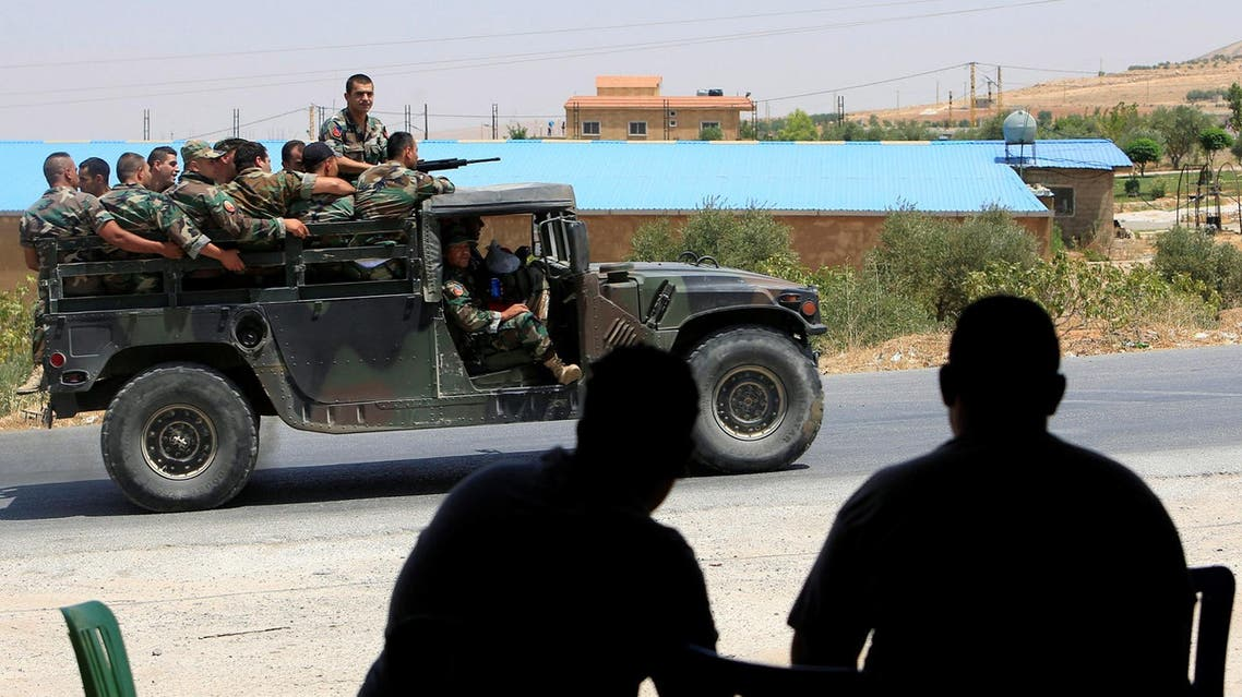 People watch as Lebanese army soldiers patrol a street in Labwe, at the entrance of the border town of Arsal, in Bekaa Valley, Lebanon July 22, 2017. (Reuters)