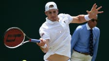 Isner achieves rarity by winning event without facing break point