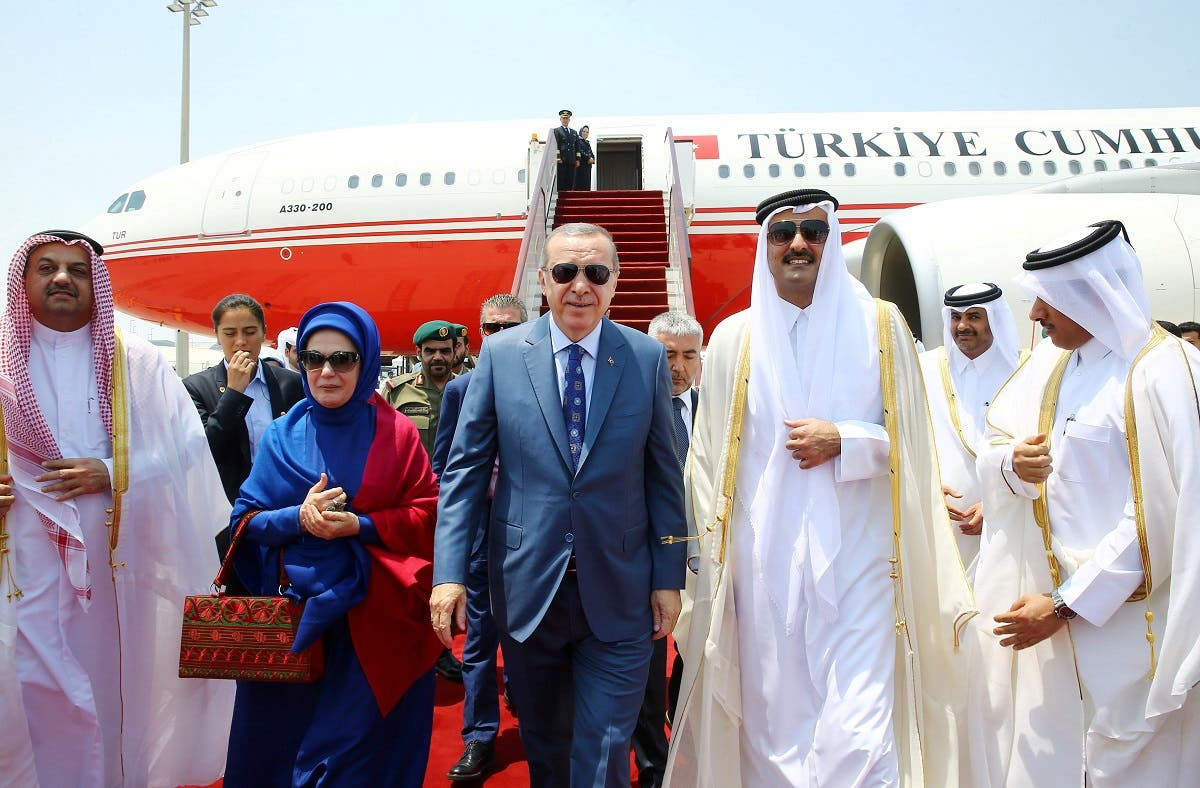 Turkish President Tayyip Erdogan is welcomed by Emir of Qatar Sheikh Tamim Bin Hamad Al-Thani in Doha REUTERS