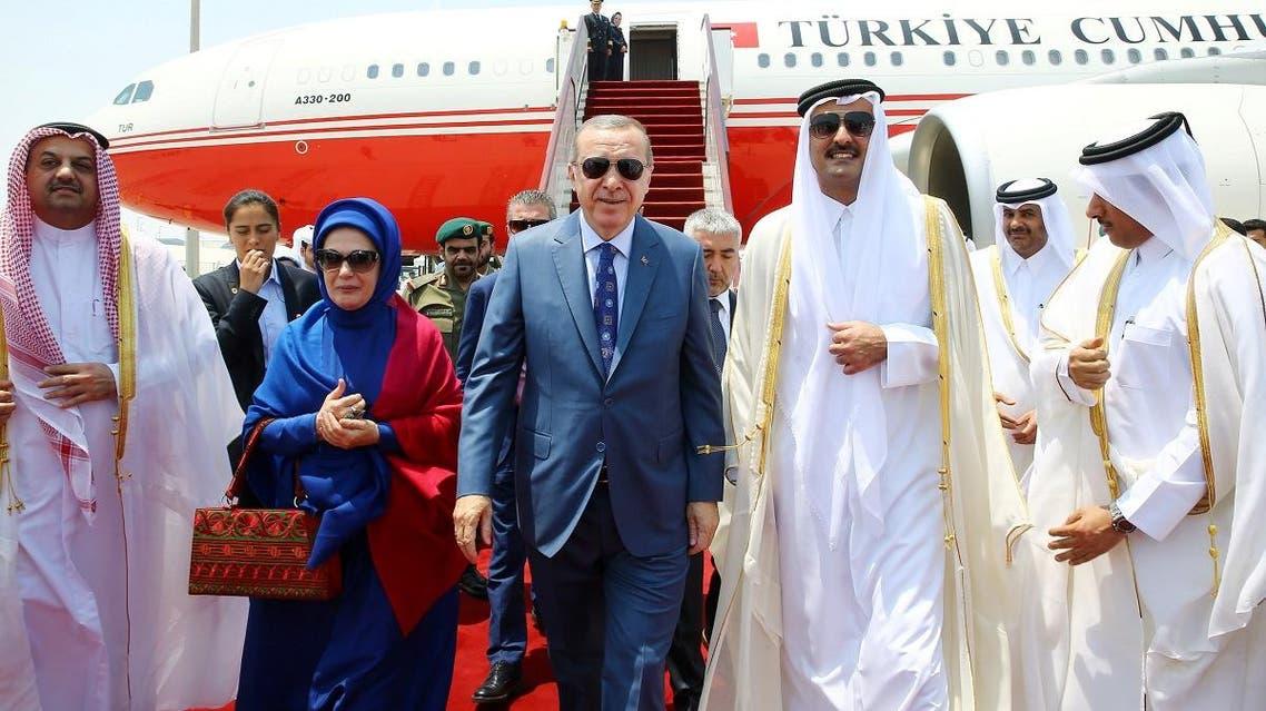 Turkish President Tayyip Erdogan is welcomed by Emir of Qatar Sheikh Tamim Bin Hamad Al-Thani in Doha REUTERS