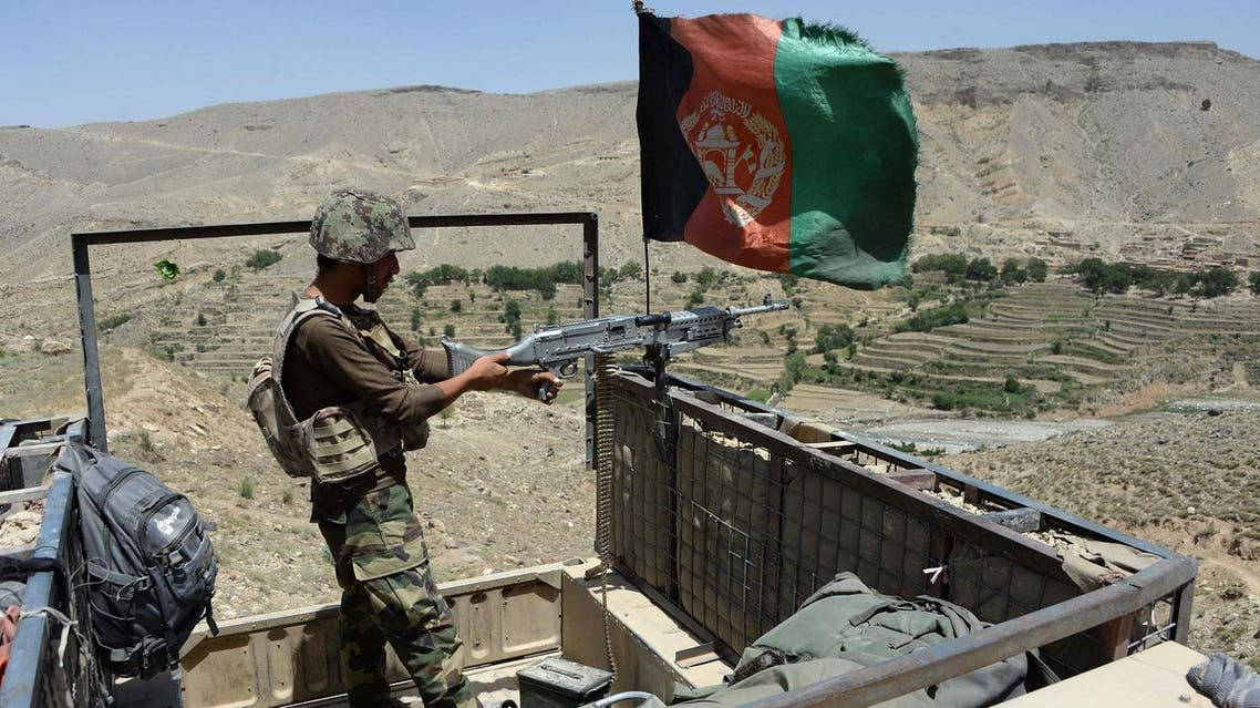 In this photograph taken on June 16, 2017 Afghan security force take positions during an operation against ISIS militants in the Tora Bora village of Pachir Aw Agam district in Nangarhar province. (AFP)