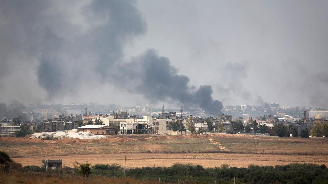 A picture taken from the southern Israeli Gaza border shows smoke billowing from the coastal Palestinian enclave during shelling by the Israeli army on July 22, 2014. UN chief Ban Ki-moon urged Israel and the Palestinians to stop the bloodshed in Gaza as he sought to broker an end to a fortnight of deadly violence. AFP PHOTO /MENAHEM KAHANA