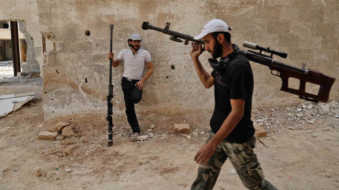 Syrian rebel fighters from the Faylaq al-Rahman brigade carry their homemade 12.7mm sniper rifle in Ain Tarma, eastern Ghouta, on July 20, 2017. (AFP)