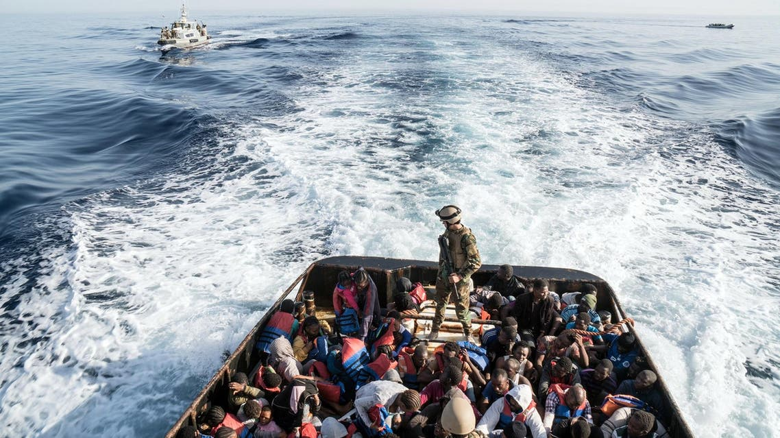 A Libyan coast guardsman stands on a boat during the rescue of 147 illegal immigrants attempting to reach Europe off the coastal town of Zawiyah on June 27, 2017. (AFP)