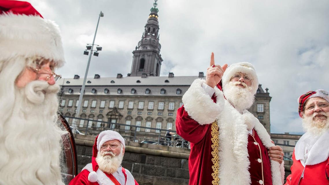 People dressed as Santa Claus take a canal tour of Copenhagen as they take part in the World Santa Claus Congress, an annual event held every summer at the amusement park Dyrehavsbakken, in Copenhagen, Denmark. Scanpix Denmark/Nikolai Linares/via REUTERS ATTENTION EDITORS - THIS IMAGE WAS PROVIDED BY A THIRD PARTY. DENMARK OUT. NO COMMERCIAL OR EDITORIAL SALES IN DENMARK. NO COMMERCIAL SALES.