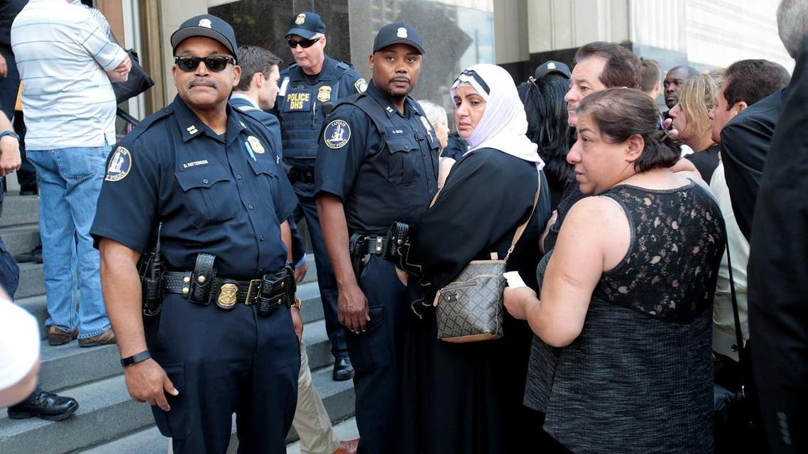 Family members of detainees line up to enter the federal court just before a hearing to consider a class-action lawsuit filed on behalf of Iraqi nationals facing deportation, in Detroit, Michigan, US, June 21, 2017. (Reuters)