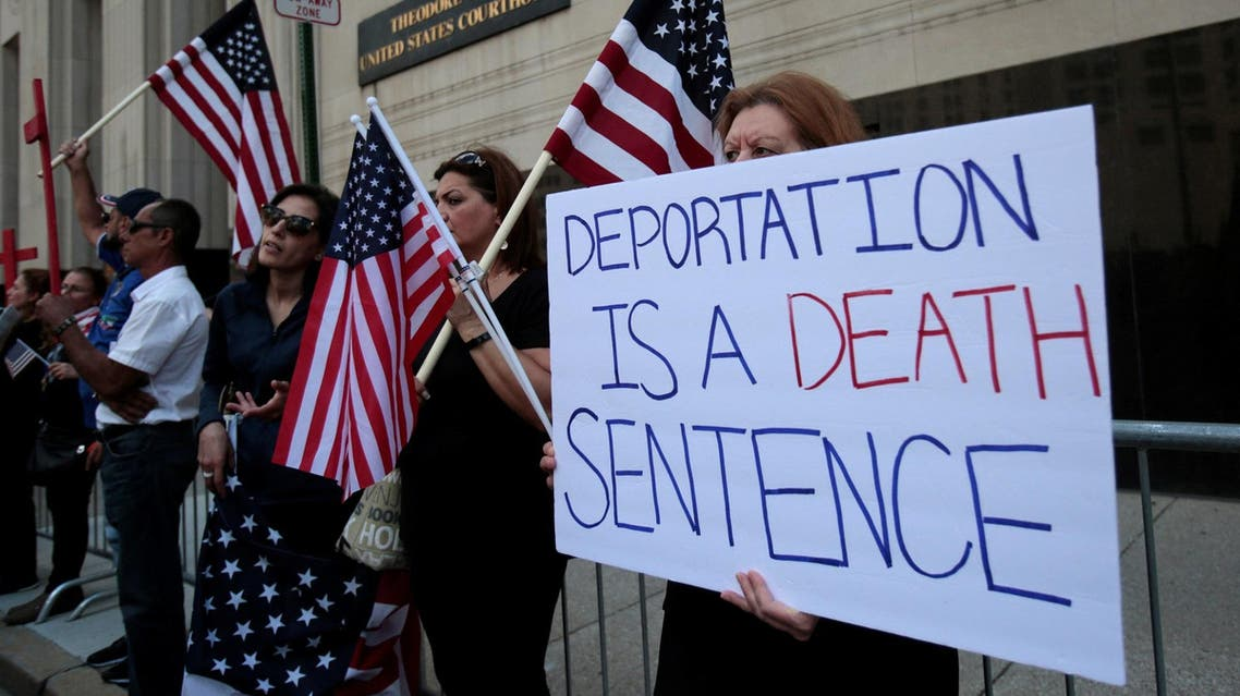 Protesters rally outside the federal court just before a hearing to consider a lawsuit filed on behalf of Iraqi nationals facing deportation, in Detroit, Michigan, US, June 21, 2017. (Reuters)